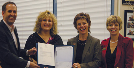 """Karen Jaegar (centre, left), co-ordinator of the IFCox parent council's """"Get Outside"""" program, and principal Melissa Gogolinski (centre, right), receive a $65,000 grant for the program from Medicine Hat MLA Blake Pedersen and Shelley Beck, constituency assistant for Cypress-Medicine Hat MLA Drew Barnes, during Thursday's parent council meeting.- PHOTO BYCHARLES LEFEBVRE"""