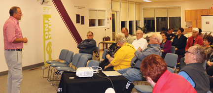 Scott Parker, associate producer to the National Film Board's The Grasslands Project, talks to Foremost area residents about the project at an information-gathering session last week.