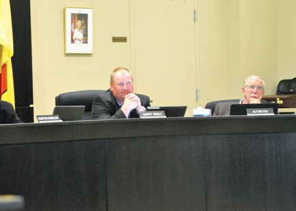 Cypress County deputy reeve, Darcy Geigle and Ward 9 councillor Alf Belyea watch on during a county meeting last week.