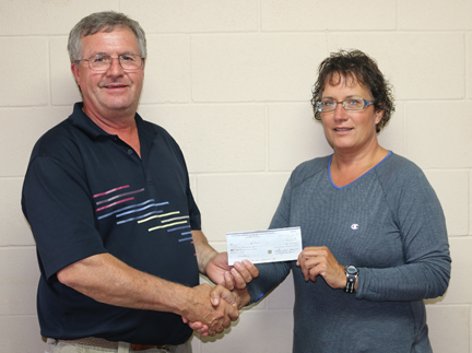 Dale Thacker, chair of the HALO board of directors accepts a cheque for $5,000 from Laurie Haynes of the Bow Island-Foremost Victim Assistance Association.