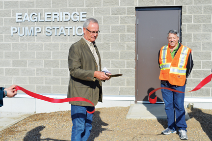 Cypress County outgoing reeve, Richard Oster cuts the ribbon to declare the new Eagleridge pump station in Dunmore and the $14.3-million Dunmore-Irvine-Walsh pipeline open on Friday afternoon.