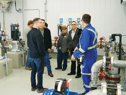 Cypress County councilors and staff take a tour of the Eagleridge pump station in Dunmore from DAin Perrior, senior utility operator. The new pump station will be the main transit point for water coming from Medicine Hat to Irvine and Walsh.
