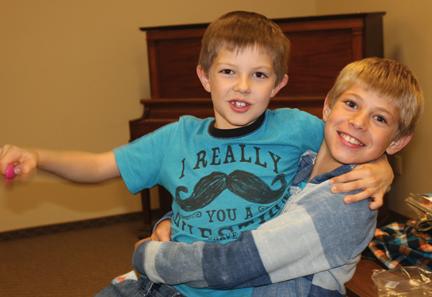 Jaxson Snortland and Julian Laqua had fun in the Kids' Room at the pumpkin festival.