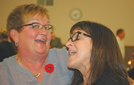 Bonnie Campbell and Carla Robertson share a song and dance at the gala last Friday.