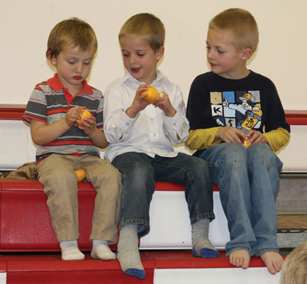 These young boys were enjoying their mandarin oranges while sitting on the top tier of the bleachers at last Friday's fundraiser at Cherry Coulee Christian Academy.