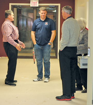 Cherry Coulee Christian Academy principal Mike Daniels (centre) takes guests at the fundraiser on a tour of the new classrooms.