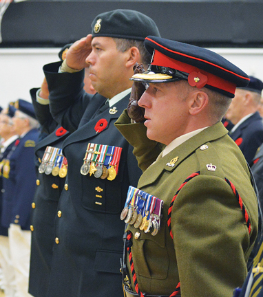 Today's soldiers honouring those of the past as Major Sadler from BATUS and Major Atwell with the Canadian Forces stationed at CFB Suffield stand side-to side, as Canadian and British soldiers have done on so many battlefields over the past 100 years.