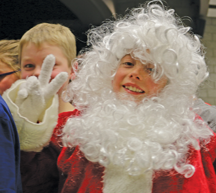 This young Santa Claus sends peace after the Bow Island Elementary/Senator Gershaw Christmas program.