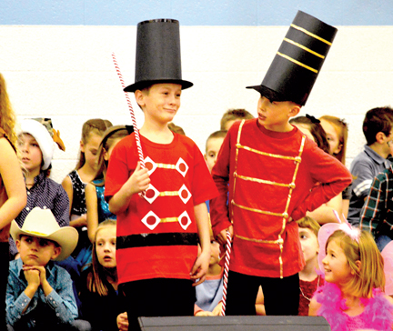 Hudson Jarvis and Reyce Devins play it up for all its worth in the Holiday Moosical on Dec. 17.