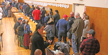 PHOTO BY JAMIE RIEGER - The community came out in droves to show their support for Burdett last Thursday evening when approximately 440 people were served dinner at the school's annual supper and auction.