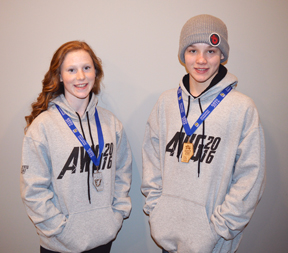 PHOTO BY TIM KALINOWSKI - Cassandra Forbes and Ryder Petrick of Redcliff were celebrating their silver and gold medal wins at the Alberta Winter Games with their family and friends last week.