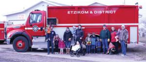 PHOTO BY JAMIE RIEGER- The youngsters from the Etzikom playgroup had a blast when the were treated to a field to the local volunteer fire department. Firefighter, George Mills was more than happy to show them around and even turned on the fire hose for them.