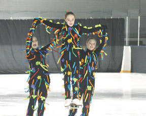 PHOTO BY TIM KALINOWSKI- The Redcliff Skating Club celebrated its 40th season with its ice carnival on Sunday. It was a packed house and the performers did not disappoint. Pictured, from left: Kaylea Suderman, Cassandra Forbes, and Jordan O'Sullivan give a Cirque du Soleil themed skate.