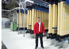 PHOTO BY TIM KALINOWSKI- Jamie Garland, Redcliff's public services director, stands in front of the state-of-the-art Pall Membrane System tubes. the tubes contain hundreds of microfibres each to ensure water purity levels Redcliff has never before seen.