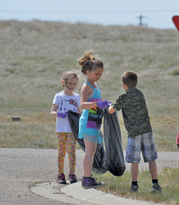 PHOTO BY TIM KALINOWSKI- Grade 2 students do their part to keep their village neat and tidy.