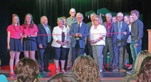 PHOTO BY JAMIE RIEGER- With Senator Gershaw students holding the ends of the ribbon, and flanked by PRSD and local dignitaries, Stuart Angle (centre), board chair, cuts the ribbon.