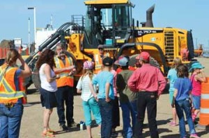 Photo by Tim Kalinowski- Cypress County Health and Safety supervisor, Tim Davies speaks with Schuler School students after the Public Works road-building display.