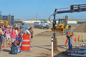 Photo by Tim Kalinowski- Irvine students watch the drilling display.