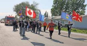 PHOTO BY JAMIE RIEGER- Led by Cst. Andrew Crouse of the Bow Island/Foremost RCMP detachment, members of the Bow Island Royal Canadian Legion, along with donation and award recipients, paraded to the Legion on Thursday evening for a celebration of the 70 anniversary of the local Legion.