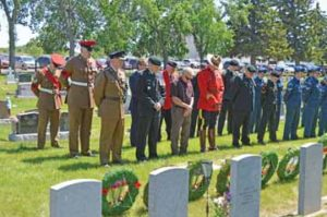 PHOTO BY TIM KALINOWSKI- Guests, including from BATUS, CFB Suffield, RCMP, and cadets joined Redcliff Legion members in a moment of silence during the Decoration Day ceremony held Sunday at the Redcliff cemetery.