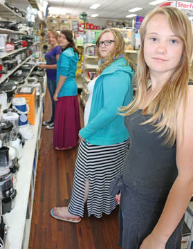 Photo By Jamie Rieger-  A group of Burdett School students recently learned a bit about the ins and outs of home decorating. With the guidance of teacher, Ingrid Dekker, the girls learned about colour schemes, how to decorate large spaces, and the cost of decorating a home. Pictured above are (From rear to front): Anna Hamm, Eva Fehr, Suzie Hamm, and Lissa Hamm. Also participating were Amanda Wiebe, Nellie Wall, Aganetha Knelsen, and Amy Froese. The girls visited the Hardware store in Bow Island recently to learn about how much it would cost to decorate and equip a kitchen.
