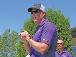 Photo By Jamie Rieger- Troy Loney gives words of encouragement prior to the start of the charity golf tournament.
