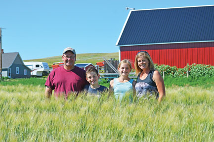 Photo by Tim Kalinowski Cypress County's  Neubauer Family, (Mark, Logan, Evi and Nichole), were recently awarded the Farm Family of the Year Award for their dedication to teaching about the agricultural way of life.