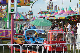 Photo by Tim Kalinowski Day at the fair for the Stampede Exhibition and Stampede.