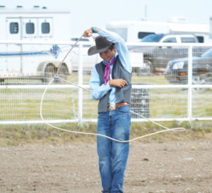 Photo by Tim Kalinowski- Cooper Resch gives a trick-roping demonstration for the crowd.