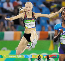 Canada's Sage Watson, left, competes in a women's 400-meter hurdles semifinal during the athletics competitions of the 2016 Summer Olympics at the Olympic stadium in Rio de Janeiro, Brazil, Tuesday, Aug. 16, 2016. (AP Photo/David J. Phillip)