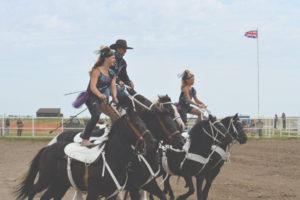 Photo by Tim Kalinowski- Young Gunz Trick Riders strut their stuff Roman style at the Ralston Rodeo.