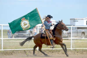Photo by Tim Kalinowski- Carrying in the CFB Suffield banner at the Ralston Rodeo.