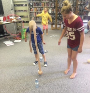 Photo submitted by Megan Kurtz- Cyndi Dalton (yellow hoodie), Morgan Unrau (red shirt), and Lincoln Kurtzweg take part in one of the fun games at the wind-up party.