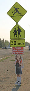 Photo by Jamie Rieger-A bright, clearly marked sign posted at the west end of the school zone by Senator Gershaw School reminds motorists to slow down.