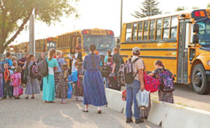 Photo by Jamie Rieger- Burdett School prinicipal Laurie Cooper calls out the names of her students as the board their buses at Bow island Elementary to head to Burdett School on the first day of classes last week.