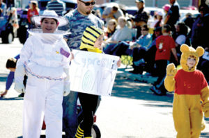 Photo by Tim Kalinowski- This year's 20 Mile Post Days in Irvine had great weather and plenty of community spirit. Pictured: Something sweet is going on at Cypress Hills Honey for the parade.