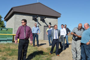 Photo by Tim Kalinowski- Redcliff Public Services director, Jamie Garland (left) gives a tour of the town's new flood-proofed river pump system that was installed as part of the $20-million water treatment plant project.