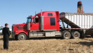 Joe Waldner watches the grain filling the truck.
