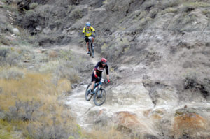 Photo by Tim Kalinowski- Approimately 50 bikes came out for the first annual Test for Humanity race in Redcliff on Saturday. Pictured: Phil Rogers (top) and Justin Kuryluk of Medicine Hat challenge the Redcliff coulees.