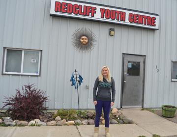 PHOTO BY TIM KALINOWSKI- The Redcliff Youth Centre is looking for urgent, immediate financial support to avoid closure by the end of December. Pictured: Youth Centre program coordinator Danielle Lank was out beating the bushes looking for financial support for her Youth Centre kids.