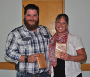 Photo by Jamie Rieger- Jeremy Mitchell, owner of Unity Electric, proudly displays the plaque he and his home-based business earned at the recent Small Business Awards night in Bow Island. Mitchell is pictured with Erna Varekamp, whose Erna's Rolling Pin Bakery and Cafe won Small Business of the Year.
