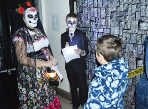 Photo by Tim Kalinowski- Parkside French students welcome Margaret Wooding students to the Day of the Dead.