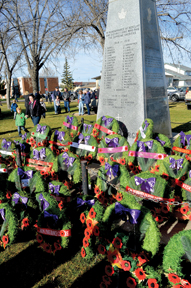 Photo by Tim Kalinowski Cenotaph and wreaths glow in the light of a beautiful sun at the Remembrance Day ceremony held in Redcliff on Friday.