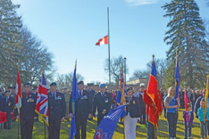 Photo by Tim Kalinowski Front and centre; Redcliff's colour party led a 300 person parade into Legion Memorial Park on Friday.