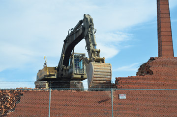 Photo by Tim Kalinowski- Crews were on site at the century-old Redcliff Pressed Brick plant last week to begin the demolition process. The work marks the end of an era in Redcliff's history.