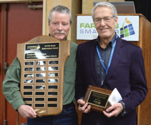 Photo by Tim Kalinowski- Lethbridge area farmer Ike Lanier (right) receives the 2016 Orville Yanke Award from Rob Runne at the Farming Smarter conference in Medicine Hat.