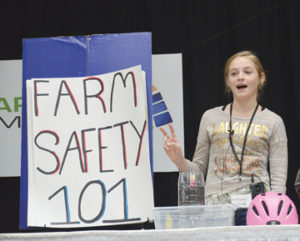 Photo by Tim Kalinowski- Local 4H member Evi Neubauer delivers a speech on farm safety to Farming Smarter delegates last Thursday at the Medicine Hat Lodge,