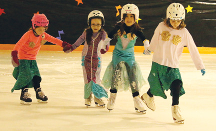 "These young CanSkate girls skate to ""Under the Sea"", from the movie The Little Mermaid at the annual Bow Island Skating Carnival, held on Saturday evening."