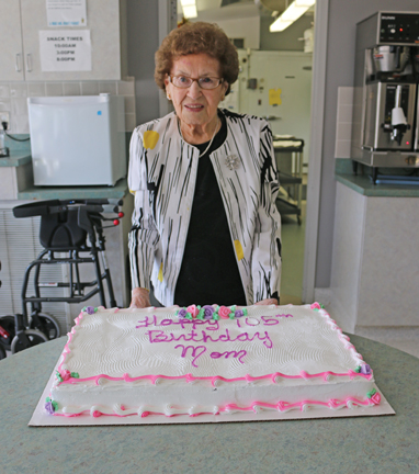 Mary Ell poses with her birthday cake at her 105th birthday party held at Pleasant View Lodge on Saturday.