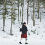 PHOTO BY TIM KALINOWSKI - Piper Matt Acton of the South Alberta Pipes and Drums practices prior to the Winter Games launch on Saturday.
